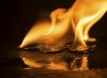 A small pile of coins on fire